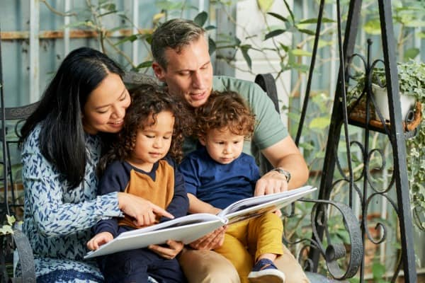 family reading book together